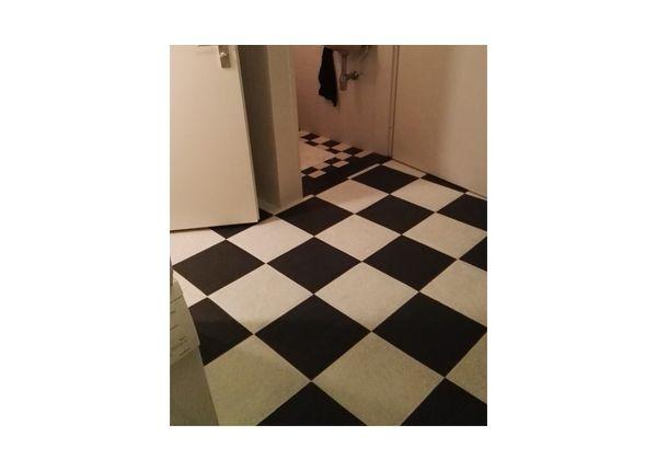 Tegelvloer in zwart wit